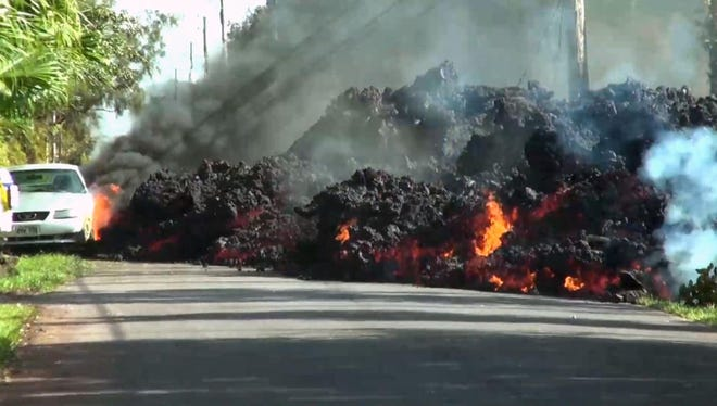 A still from the video of lava engulfing a car in Hawaii