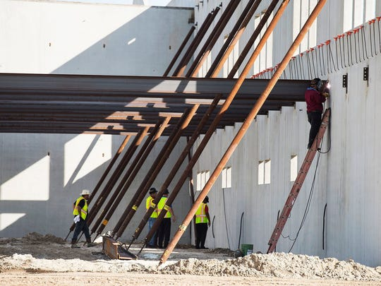 Roof trusses will be up soon at Bonita Springs High School. Workers are seen during construction of the new high school in Bonita Springs, Fla., on Thursday, June 29, 2017.