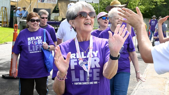 Stow-Munroe Falls and Hudson Relay for Life is Aug. 15. Judy Valovcik gets high fives as she walks the first lap for survivors at the 2019 Relay event.
