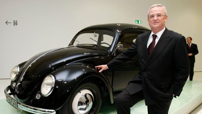 Martin Winterkorn:  The Volkswagen Group CEO resigned in September after the scandal erupted. He poses with a 1950 Beetle.