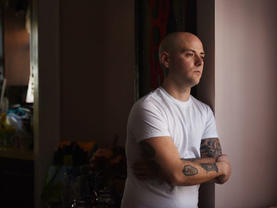 Matt Albanese, a Cliffside Park resident, who was picked up for heroin possession during April's Operation Helping Hand, looks toward the outside from his home in Cliffside Park on 01/02/18. Albanese has stayed clean since his arrest in the sweep, which was done by the Bergen County Prosecutor's Office, and has his life back on track after seven years of addiction.