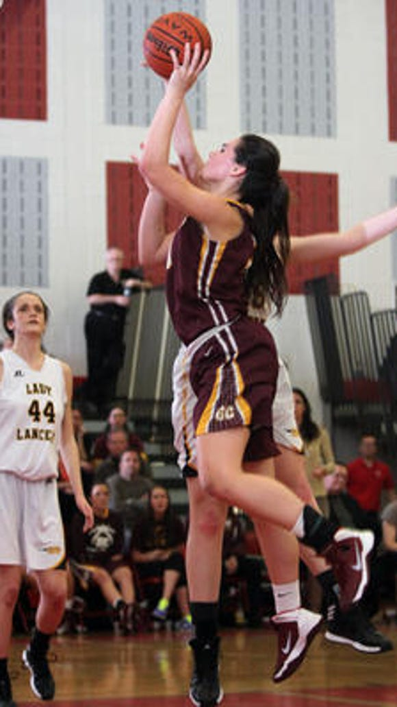 Gloucester Catholic's Mary Gedaka goes up for a basket.