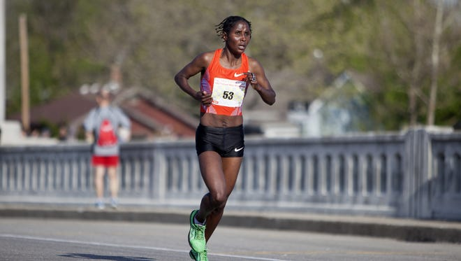 FILE – Lilian Mariita runs her last miles during the OneAmerica 500 Festival Mini-Marathon, May 3, 2014. She won the women's division with a time of 1:12:04.