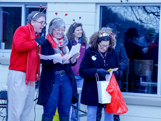 """From left, Roy Murdough, Carol Miller and Judy Epstein read off the winners of """"Cutest Costume"""" at the first Ithaca Chill Challenge."""