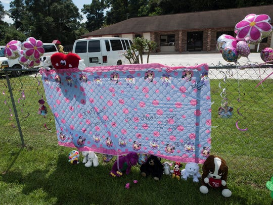 A makeshift memorial has been erected outside In His