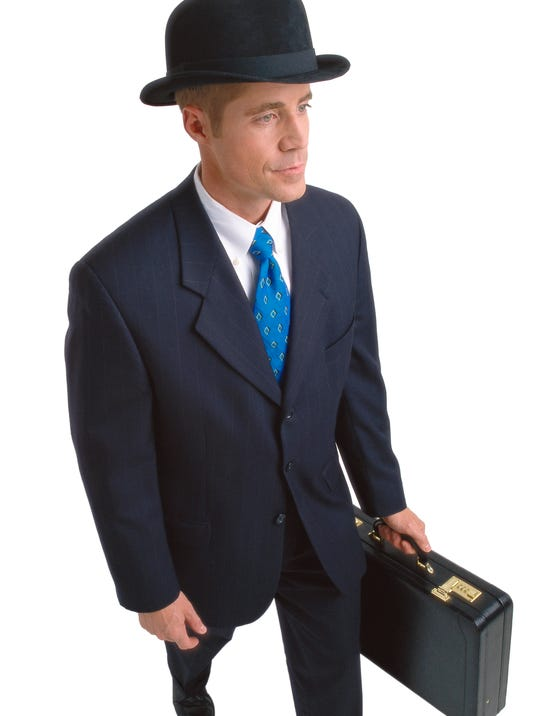 high angle view of a businessman walking carrying a briefcase