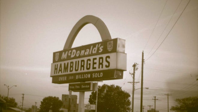McDonald's Eighth Street and Indiana Avenue location is no longer, but this photo from about 1995 shows the store and the classic sign from the early days. McDonald's was unable to take the sign to its new Cliff Avenue store.