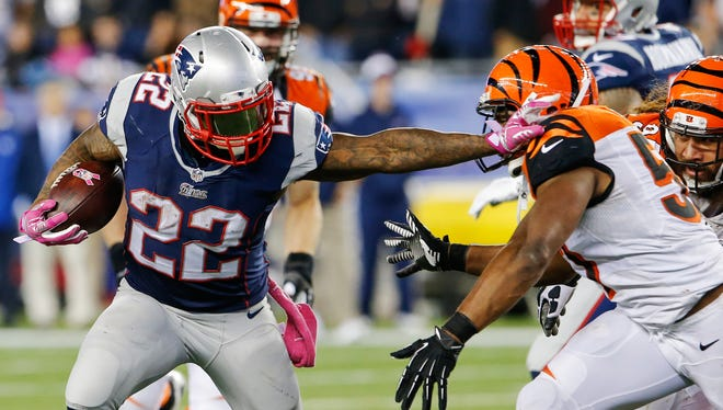 Stevan Ridley runs the ball against the Bengals