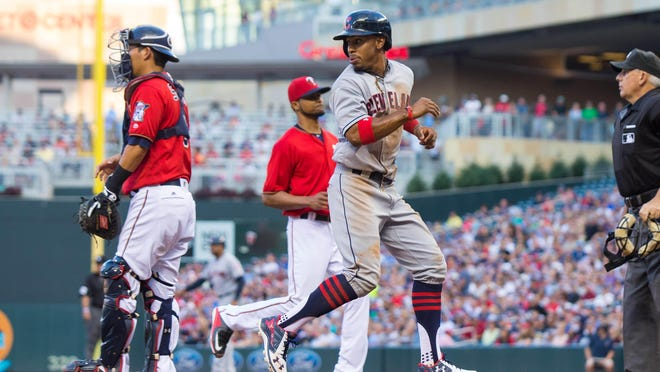 Cleveland Indians shortstop Francisco Lindor (12) scores in the fourth inning against the Minnesota Twins on Friday at Target Field in Minneapolis.