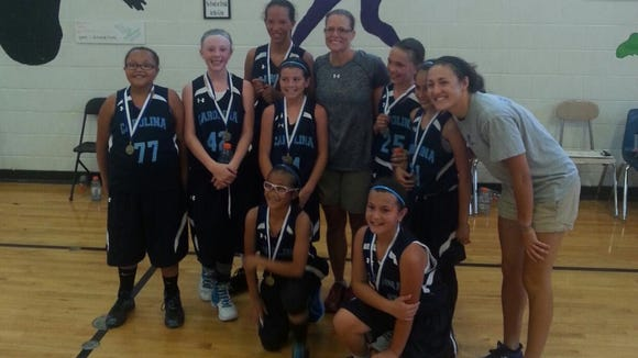 The Team Carolina-Asheville fifth-grade girls basketball team won the Kings Dominion Invitational tournament last weekend in Raleigh.