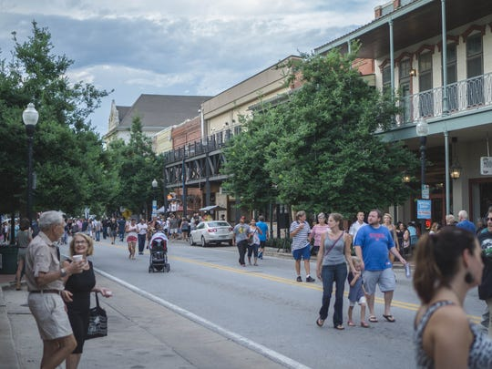 People stroll down Palafox Street as they enjoy Gallery Night in August.