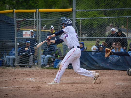 Barreling up a pitch for Livonia Franklin is junior Ryan Celmer, during Saturday's Livonia Baseball  City Championship final.