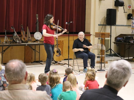 Linda Littleton and Karen Hirshon, of Simple Gifts, played many traditional folk instruments during a performance at the Immaculate Conception School on Friday.
