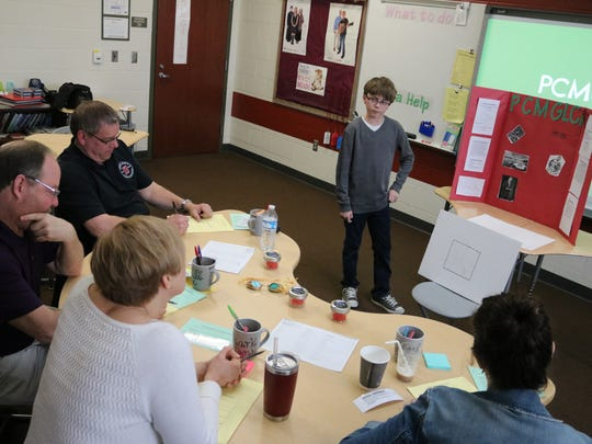 """Max Lucas presents his business idea, the Port Clinton Museum of the Great Lakes Climate Research, at Port Clinton Middle School's Young Entrepreneurs """"Shark Tank"""" event."""