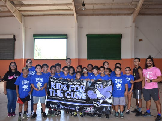 Guam Cancer Care held their Kids for the Cure program at Agana Heights Elementary School with over 200 student participants. Pictured is Ms. Terlaje and her fifth grade class who placed third, Principal Hannah Gutierrez, Kids for the Cure coaches and Guam Cancer Care staff.