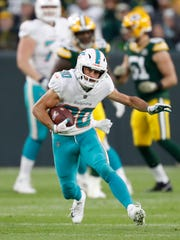 In this Nov. 11, 2018, file photo, Miami Dolphins' Danny Amendola runs after a catch during the first half of an NFL football game against the Green Bay Packers, in Green Bay, Wis.
