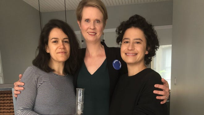 """Cynthia Nixon stands with the stars of """"Broad City"""" to show a signed bong that she is raffling off for her gubernatorial campaign"""