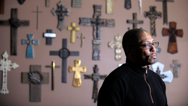 Kevin Lancaster, 51, of Harrison Twp., senior pastor of the Love Life Family Christian Center, talks to The News in front of more than 30 crosses he's collected for the last 10 years. The pastor is among those who are speaking out about a federal complaint against the city of Eastpointe, alleging that its at-large city council elections are racially discriminatory.