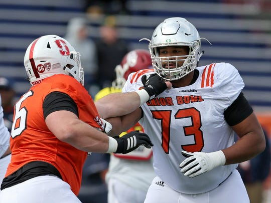 Oregon's Tyrell Crosby blocks Stanford's Harrison Phillips during 2018 Senior Bowl practice. Crosby has experience at both tackle positions.
