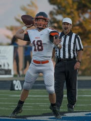 Douglas quarterback Hunter Hickey throws against McQueen last season.