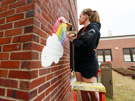 Colleen Quinn of Mt Olive paints a rainbow as a realty