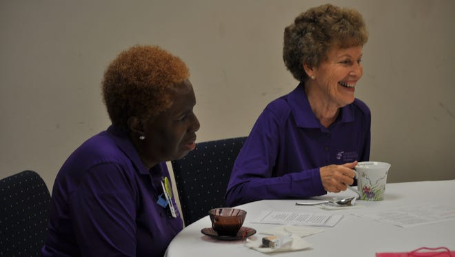 Mary Bailey (left) and Betty Rogers (right) enjoy tea at Christus St. Frances Cabrini Hospital during an auxiliary appreciation tea for the 75 volunteers who donate their time to the hospital each week.