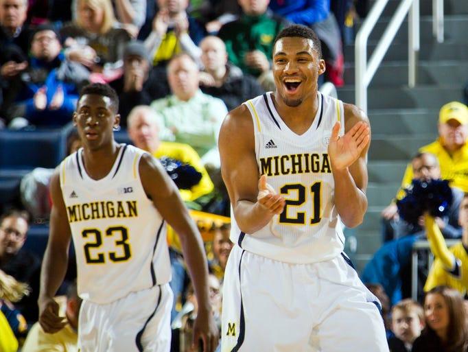 Michigan guard Zak Irvin (21) reacts after a basket