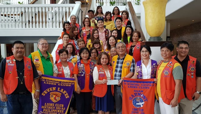 """Sight for Kids Project: Guam Harmony Lions Club, LCI District 204, donated $1,500 to their twin club, Seven Lakes Lions Club, District 301-A2 Philippines, headed by Atty. Lion Hizon Arago Oct. 28 at the La Cascata, Sheraton Resort & Spa. The money will be used to help purchase a spot machine to screen vision for 6,000 children from Pre-K to 6th grade in the province of San Pablo City, Laguna. This a joint humanitarian community project by both Lions Clubs to address our crusade against darkness by restoring vision and fight preventative blindness. Lions around the world had been challenged by Helen Keller as the """"Knights of the Blind."""""""