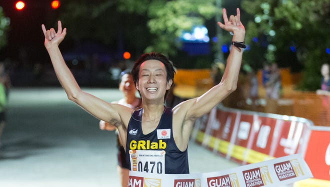 First male finisher for the full marathon, Hiroki Nakajima crosses the finish line during the 2016 Guam International Marathon held at Ypao Beach on April 10.