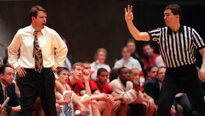 Former Iowa State coach Tim Floyd (left) disagrees with an official in a 1996 game.