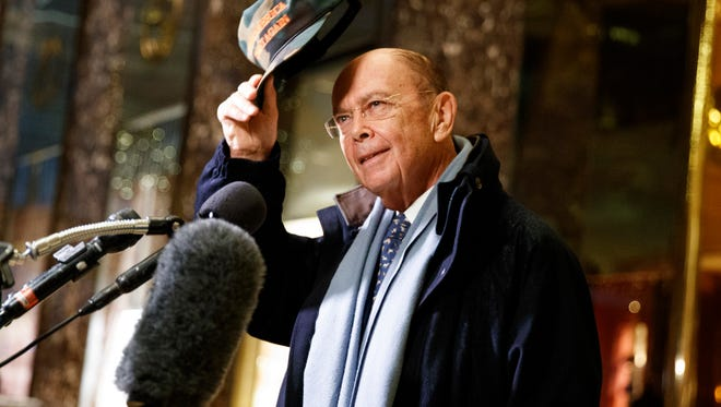 Billionaire investor Wilbur Ross, set to be the next Commerce secretary, talks with reporters in the lobby of Trump Tower, Tuesday, Nov. 29, 2016, in New York.