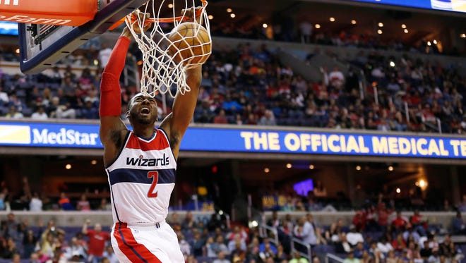 Apr 12, 2015; Washington, DC, USA; Washington Wizards guard John Wall (2) dunks the ball against the Atlanta Hawks in the fourth quarter at Verizon Center. The Wizards won 108-99. Mandatory Credit: Geoff Burke-USA TODAY Sports