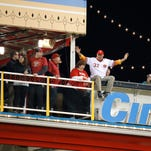 Former Reds pitcher Tom Browning sits on the railing at the Riverboat Deck in center field during a game in April against the Cubs.