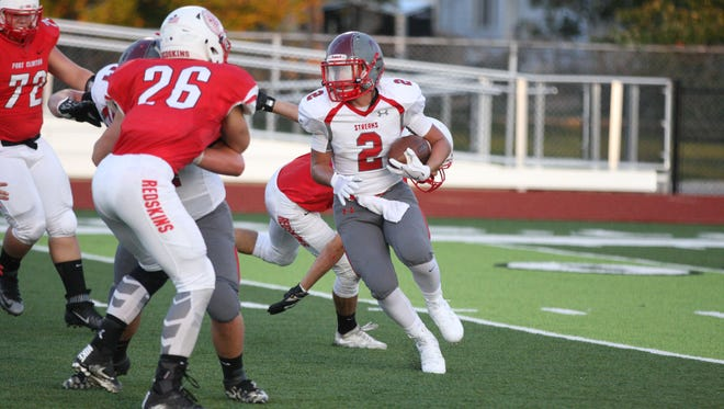 SJCC's Benton Snyder carries the ball against Port Clinton.