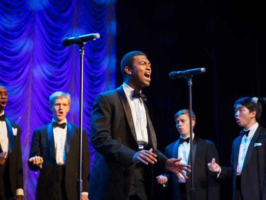 Michael Wingate (center) sings with the Harvard Krokodiloes.