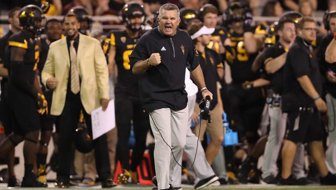 ASU head coach Todd Graham celebrates after Washington missed a field goal in the second half at Sun Devil Stadium on Oct. 14, 2017 in Tempe. The Sun Devils defeated the Huskies 13-7.