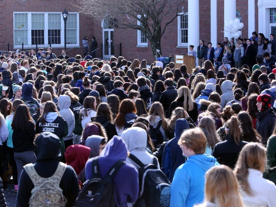 Pleasantville Middle and High School students participate in a national walkout of school day to raise awareness about school safety and gun reform March 14, 2018.