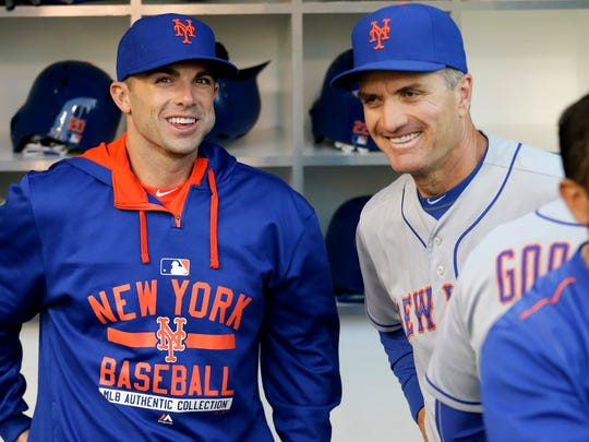 New York Mets bench coach Bob Geren, right, jokes with third baseman David Wright,before the Mets played the San Diego Padres in a game Tuesday, June 2, 2015, in San Diego.