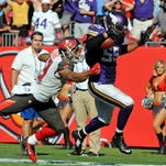 Minnesota Vikings outside linebacker Anthony Barr (55) breaks the tackle of Tampa Bay Buccaneers wide receiver Mike Evans (13) for a 27-yard fumble recovery for a touchdown to win the game as the Vikings beat the Tampa Bay Buccaneers 19-13 in overtime at Raymond James Stadium.