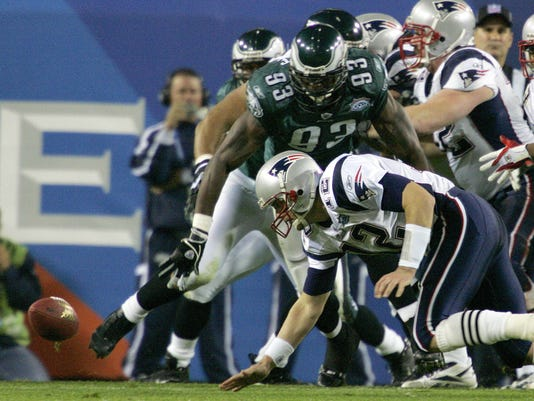 FILE - In this Feb. 6, 2005, file photo, New England Patriots quarterback Tom Brady fumbles the ball as Philadelphia Eagles defensive end Jevon Kearse (93) moves in on the play during the second quarter of Super Bowl XXXIX at Alltel Stadium in Jacksonville, Fla. The Eagles recovered the fumble. The two teams meet in a rematch in Super Bowl 52 on Sunday, Feb. 4, 2018, in Minneapolis. (AP Photo/Gene J. Puskar, File)