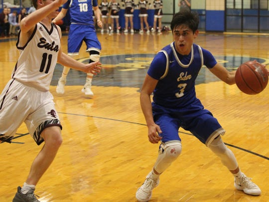 Eden High School's Donovan Gonzales (3) dribbles around Eula's Cade Smith during a Class 1A Region II regional quarterfinal basketball playoff at the Coleman gym on Tuesday, Feb. 27, 2018.