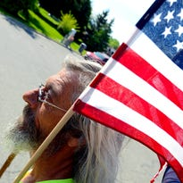 Leroy Bailey walks down Grand River Avenue Friday, May 20, 2016, on part of his two-year journey to walk the perimeter of the United States. Bailey, who started his journey in Virginia Beach, is doing this to raise awareness of homeless veterans in the country. He is heading east toward Detroit, and hopes to finish sometime this fall.