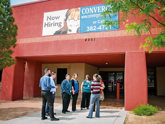 Workers at the Convergys call center take a break for a few minutes Thursday before the arrival of Gov. Susana Martinez in 2015.