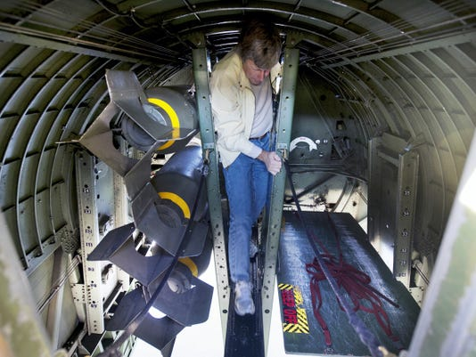 Ron Comune, of Carlisle, walks along a narrow catwalk of the bomb bay of one of the bombers during the The Wings of Freedom Tour, which includes a WWII Boeing B-17 Flying Fortress, Consolidated B-24 Liberator, North American P-51 Mustang, and a B-25 Mitchell at Capital City Airport. The planes remain on display Wednesday.