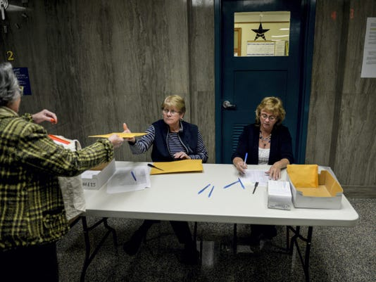Sally Templin hands in the ballots from West Lebanon Township to Gladys Walborn, center, and Belinda Spicer, right, at the Lebanon County Municipal Building Tuesday night. Voters across the county turned out to pick officials for local offices.