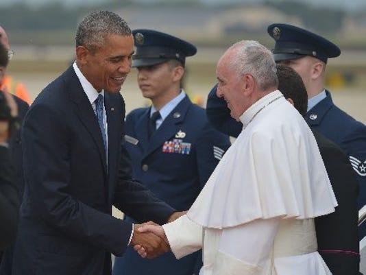President Barack Obama greets Pope Francis