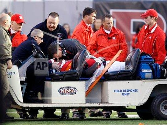 Schiano leaning over LeGrand in the moments following LeGrand's injury on Oct. 16, 2010.