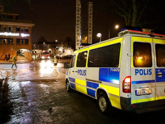 A police car in the suburb Rinkeby outside Stockholm, Monday Feb. 20, 2017.  Swedish police on Tuesday were investigating a riot that broke out overnight in a predominantly immigrant suburb in Stockholm after officers arrested a suspect on drug charges. The clashes started late Monday when a police car arrested a suspect and people started throwing stones at them.
