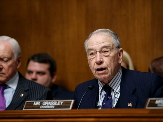 Senate Judiciary Committee Chairman Sen. Chuck Grassley, R-Iowa, right, accompanied by Sen. Orrin Hatch, R-Utah, speaks on Capitol Hill in Washington, Tuesday, March 7, 2017, at the start of the committee's confirmation hearing for Deputy Attorney General-designate, federal prosecutor Rod Rosenstein,