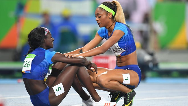 New Rochelle High graduate Deajah Stevens, right, embraces fellow American Tori Bowie after Bowie won the bronze medal in the women's 200 meters Wednesday night. Stevens finished seventh.